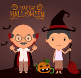 Happy smiling seniors in Halloween costumes Royalty Free Stock Photos