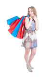 Happy smiling shopaholic with many big shopping bags Royalty Free Stock Image