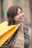 Happy smiling shopping woman Stock Photos