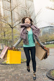 Happy smiling shopping woman jumping Royalty Free Stock Image