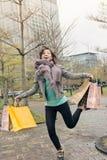 Happy smiling shopping woman jumping Stock Photos