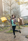 Happy smiling shopping woman jumping Royalty Free Stock Photo