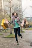Happy smiling shopping woman jumping Royalty Free Stock Photography