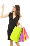 Happy smiling shopping woman pointing up to copy space Royalty Free Stock Photo