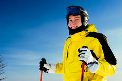Happy smiling skier. With sky in background Royalty Free Stock Photography