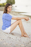 Happy smiling slim fit beautiful brunette woman on a seashore ne Stock Photo
