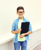 Happy smiling smart teenager boy in glasses with folder or book Royalty Free Stock Photo
