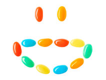 Happy smiling smiley made of multicolored candies. Isolated on white background Royalty Free Stock Images