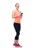 Happy smiling sportive young woman with smartphone. Sport, fitness, technology, lifestyle and people concept - happy smiling sportive young woman with smartphone Stock Images
