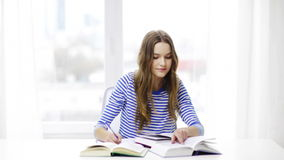 Happy smiling student girl with books stock footage