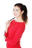 Happy smiling student girl with pen Royalty Free Stock Photography