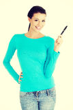 Happy smiling student girl with pen Stock Photo