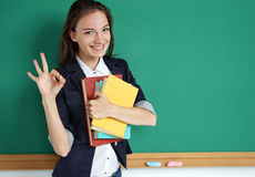 Happy smiling student showing okay gesture. Stock Photos