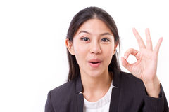 happy, smiling, successful business woman showing ok hand gesture royalty free stock images