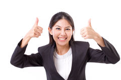 Happy, smiling, successful business woman showing thumb up gestu Stock Images