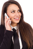 Happy smiling successful businesswoman with cell phone. Happy smiling successful businesswoman with mobil phone isolated on white background Royalty Free Stock Photography