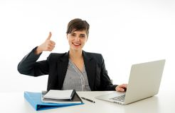 Portrait of happy attractive young businesswoman on laptop looking confident with thumb up stock photos