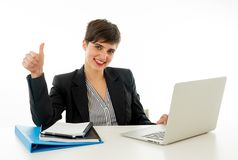 Portrait of happy attractive young businesswoman on laptop looking confident with thumb up stock images