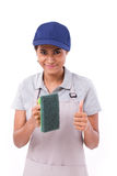 Happy, smiling, successful female cleaner giving thumb up gestur Stock Photos