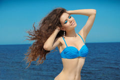 Happy smiling summer girl with long wavy blowing hair. Wellness. royalty free stock photos