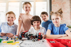 Happy smiling team of young technicians royalty free stock photo