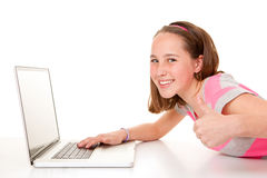 Teen with laptop computer. Happy smiling teen child with laptop computer royalty free stock images