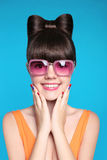 Happy smiling teen girl with bow hairstyle, funny model wearing Stock Photography