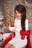 Happy smiling teen girl with long braid tied red bow and red lip royalty free stock image