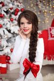 Happy smiling teen girl with long braid tied red bow and red lip royalty free stock photography