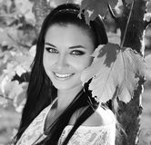 Happy smiling teen girl outdoors portrait. Black and white photo Stock Photos