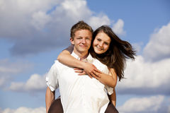 Happy smiling teenage couple Royalty Free Stock Images