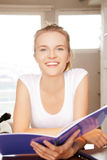 Happy and smiling teenage girl with big notepad Stock Photos