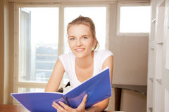Happy and smiling teenage girl with big notepad Royalty Free Stock Photography