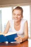 Happy and smiling teenage girl with book Stock Image