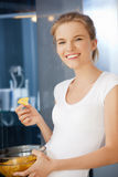 Happy and smiling teenage girl with chips Stock Image