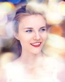 Happy and smiling teenage girl with city lights Royalty Free Stock Image