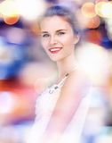 Happy and smiling teenage girl with city lights Royalty Free Stock Photos