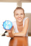 Happy and smiling teenage girl with clock Stock Photo
