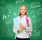 Happy and smiling teenage girl. Education and school concept - happy and smiling teenage girl stock image