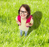 Happy smiling teenage girl in eyeglasses with bag Royalty Free Stock Images