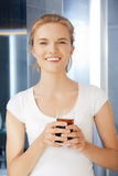 Happy and smiling teenage girl with glass of cola Royalty Free Stock Image