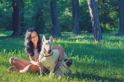 Happy smiling teenage girl with her pets pug dog and bull terrier Stock Photos