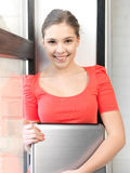 Happy and smiling teenage girl with laptop Stock Images