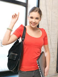 Happy and smiling teenage girl with laptop Stock Image