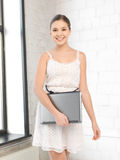 Happy and smiling teenage girl with laptop Stock Photos