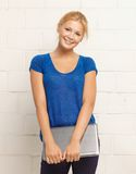 Happy and smiling teenage girl with laptop Royalty Free Stock Images