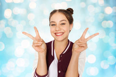 Happy smiling teenage girl showing peace sign Stock Photos