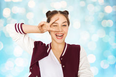 Happy smiling teenage girl showing peace sign Stock Photography