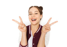 Happy smiling teenage girl showing peace sign Royalty Free Stock Image