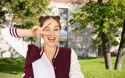 Happy smiling teenage girl showing peace sign Royalty Free Stock Photography